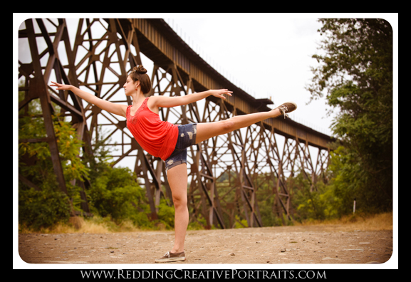 dancing senior photo at deisel horse bridge